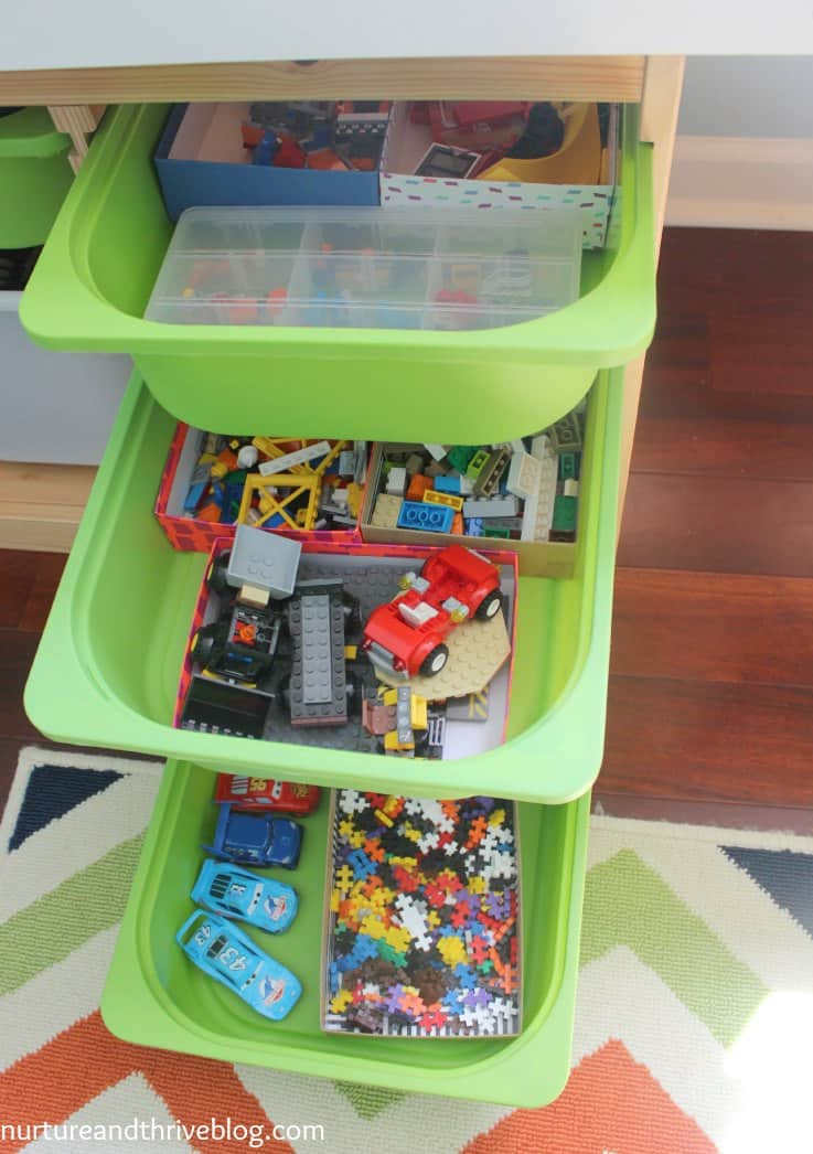 I love the storage in this playroom. So many good ideas on how to create a great play area! Ikea hacks!