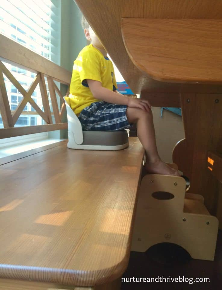 Tip 2: Sensory Input for feet and proper position for sitting at the table. Big kids need booster too!