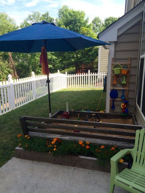 Attach an umbrella to your sandbox for shade