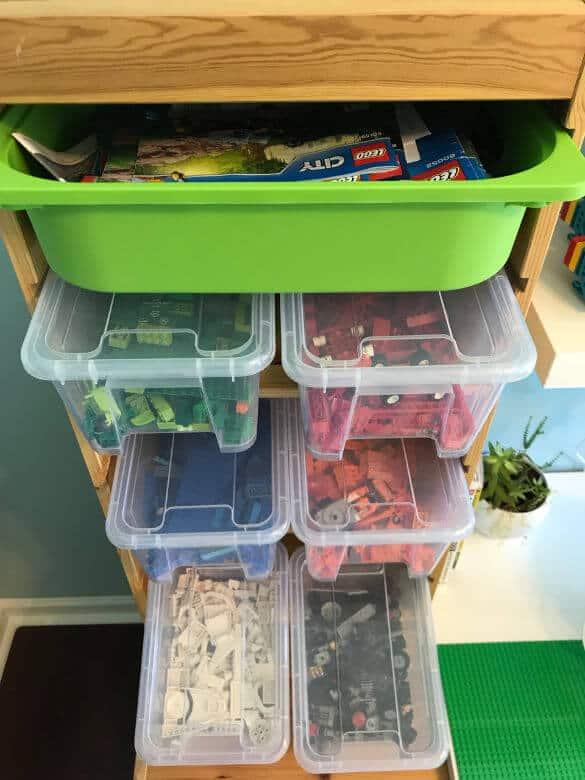 Lego storage in clear bins in playroom
