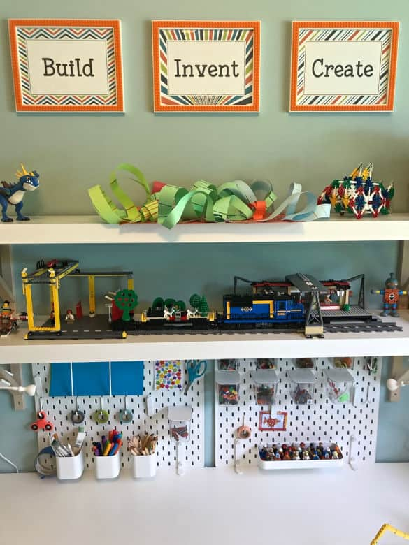 Makerspace playroom for older kids with pegboard and toy storage