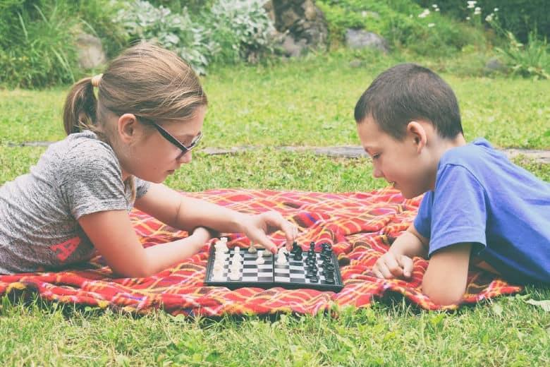 Kids playing chess, a real-world challenge. Kids unplugged.
