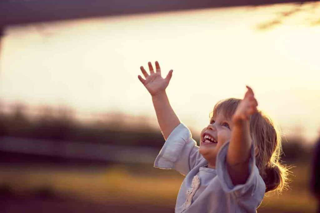 Image of a child with a large smile, showing exuberance.